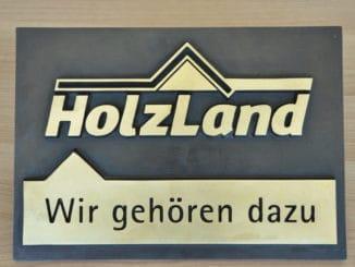 """Das neue Holzland-Signet """"Wir gehören dazu""""."""